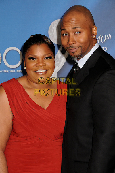 MO'NIQUE & SIDNEY HICKS.40th Annual NAACP Image Awards - Arrivals at the Shrine Auditorium, Los Angeles, California, USA..February 12th, 2009.half length red dress black suit jacket married husband wife .CAP/ADM/BP.©Byron Purvis/AdMedia/Capital Pictures.