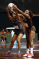 22.02.2018 Fiji's Nina Cirikisuva and Malawi's Joanna Kachilika in action during the Fiji v Malawi Taini Jamison Trophy netball match at the North Shore Events Centre in Auckland. Mandatory Photo Credit ©Michael Bradley.