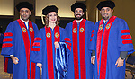 Muhammad Awni Mahmond Obeidat, left, Vjosana Mataj, Jose Luis Brito Ramos and Maktoom Rashid Humaid Al Wahaibi pose for a photo backstage before the DePaul University College of Law commencement. They received their Master of Laws degrees, Sunday, May 13, 2018, at the McCormick Place Grand Ballroom in Chicago, IL. (DePaul University/Carol Hughes)