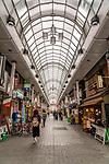 Long shopping arcade near the Sensō-ji ancient Buddhist temple located in Asakusa, Tokyo, Japan
