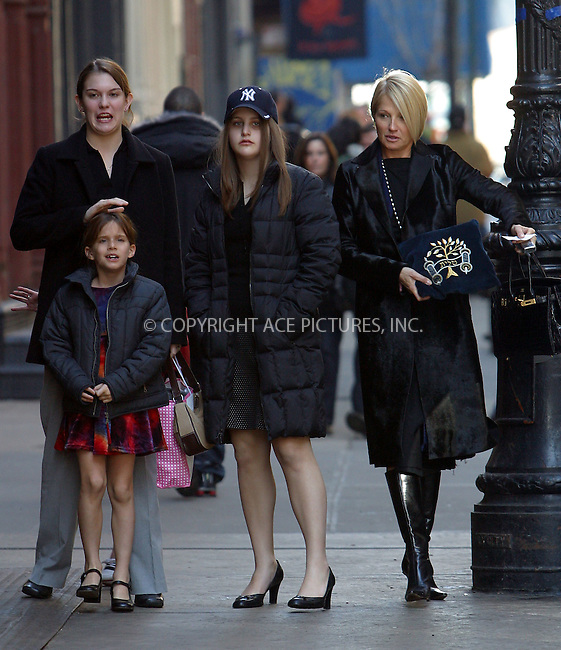 Ellen Barkin and her family arrive at Mercer Kitchen Restaurant in SoHo, New York, March 8, 2003. Please byline: Alecsey Boldeskul/NY Photo Press.   ..*PAY-PER-USE*      ....NY Photo Press:  ..phone (646) 267-6913;   ..e-mail: info@nyphotopress.com