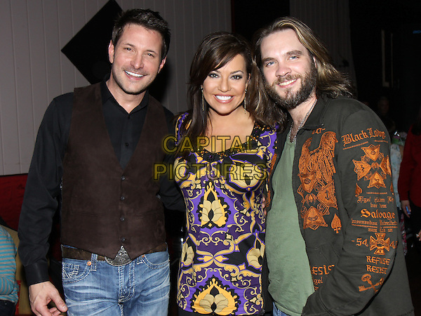 TY HERNDON, ROBIN MEADE, BO BICE .at  a benefit at The Limelight to raise funds for the Abintra Montessori School in Nashville, Nashville, TN, USA, .March 27th, 2010..half length yellow purple print top green t-shirt brown waistcoat black shirt beard facial hair smiling .CAP/ADM/DH.©Dan Harr/AdMedia/Capital Pictures.
