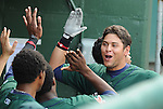 Left fielder Ronald Bermudez (22) of the Greenville Drive is congratulated in the dugout after hitting a home run in the first inning in a game against the West Virginia Power on May 2, 2010, at Fluor Field at the West End in Greenville, S.C.