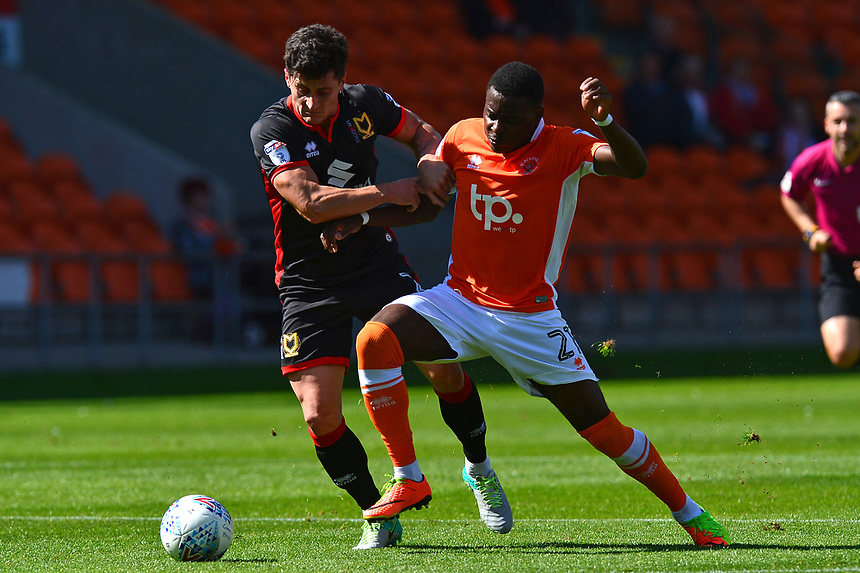 Blackpool's Bright Osayi-Samuel battles with Milton Keynes Dons' George Williams<br /> <br /> Photographer Richard Martin-Roberts/CameraSport<br /> <br /> The EFL Sky Bet League One - Blackpool v Milton Keynes Dons - Saturday August 12th 2017 - Bloomfield Road - Blackpool<br /> <br /> World Copyright &copy; 2017 CameraSport. All rights reserved. 43 Linden Ave. Countesthorpe. Leicester. England. LE8 5PG - Tel: +44 (0) 116 277 4147 - admin@camerasport.com - www.camerasport.com