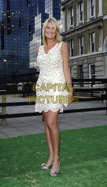 Sally Bercow.The Channel 5 Launch Party for the new series of 'Dallas', Old Billingsgate Market, London, England..21st August 2012.full length dress white sleeveless clutch bag print .CAP/DH.©David Hitchens/Capital Pictures.