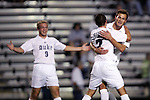 Duke's Blake Camp (r) celebrates his goal at 7:20 with teammates Tomek Charowski (7) and Mike Grella (9) on Friday, October 21st, 2005 at Koskinen Stadium in Durham, North Carolina. The Duke University Blue Devils defeated the North Carolina State University Wolfpack 6-0 during an NCAA Division I Men's Soccer game.