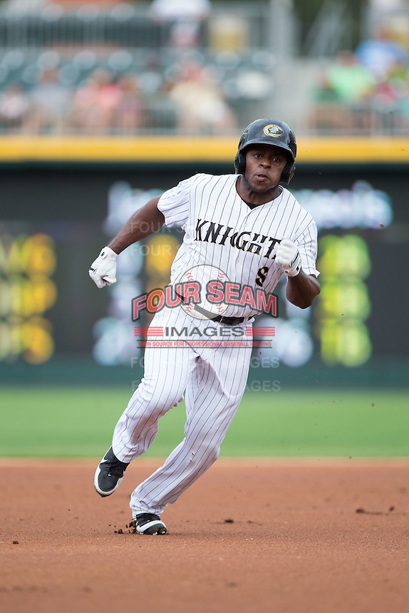 Jason Bourgeois (8) of the Charlotte Knights hustles towards third base against the Pawtucket Red Sox at BB&T BallPark on July 6, 2016 in Charlotte, North Carolina.  The Knights defeated the Red Sox 8-6.  (Brian Westerholt/Four Seam Images)