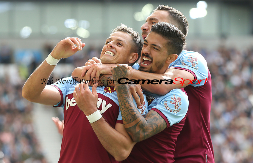 West Ham United's Javier Hernandez celebrates scoring his side's first goal with Manuel Lanzini and Robert Snodgrass<br /> <br /> Photographer Rob Newell/CameraSport<br /> <br /> The Premier League - Brighton and Hove Albion v West Ham United - Saturday 17th August 2019 - The Amex Stadium - Brighton<br /> <br /> World Copyright © 2019 CameraSport. All rights reserved. 43 Linden Ave. Countesthorpe. Leicester. England. LE8 5PG - Tel: +44 (0) 116 277 4147 - admin@camerasport.com - www.camerasport.com