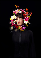 BNPS.co.uk (01202 558833)<br /> Pic: AlmaHaser/BNPS<br /> <br /> Flower power...Why wear a hat when you can wear a hedgerow.<br /> <br /> A UK flower grower and florist has created stunning floral headpieces to encourage people to buy British.<br /> <br /> Fiona Haser Bizony has created the fabulous colourful crowns to celebrate British Flowers Week, which starts tomorrow (Mon).<br /> <br /> She grew, cut and designed the headwear herself to show people cut flowers don't just have to sit in a vase on their table.<br /> <br /> Fiona, 55, is part of a grassroots movement spearheading a revival in British-grown cut flowers after imported flowers, mainly through Holland, pushed the homegrown blooms out of the market.