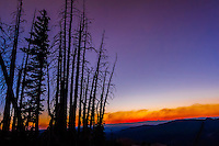 Smoke from a near by forest fire intensifies a sunset seen from Cedar Breaks National Monument, Utah, USA