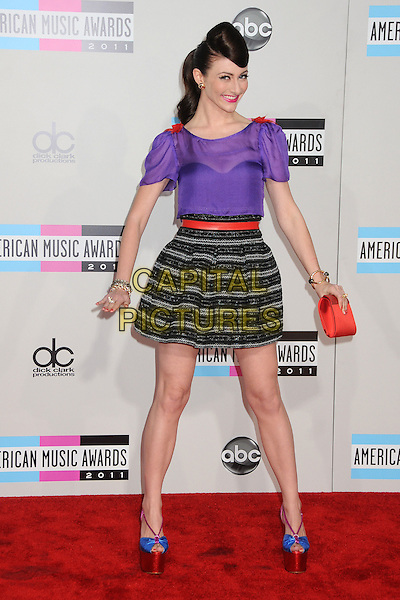 Amy Heidemann of Karmin.2011 American Music Awards - Arrivals held at Nokia Theatre LA Live, Los Angeles, California, USA..November 20th, 2011.ama amas ama's full length black grey gray striped stripes skirt purple top red belt hand on hip bows ribbons platform shoes blue sheer peep toe.CAP/ADM/BP.©Byron Purvis/AdMedia/Capital Pictures.