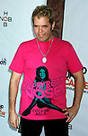 Blogger Perez Hilton arrives at the launch of Camila Alves' Handbag Collection MUXO at Kitson Studio on August 7, 2008 in Los Angeles, California.