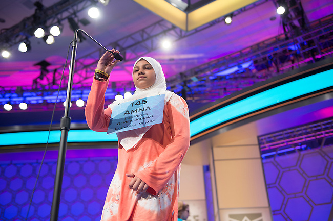 Speller No. 145, Amna Raza, 13, seventh grader at Omar Haikal Islamic Academy, Las Vegas, Nevada, competes in the preliminary rounds of the Scripps National Spelling Bee at the Gaylord National Resort and Convention Center in National Habor, Md., on Wednesday, May 29, 2013. Photo by Bill Clark