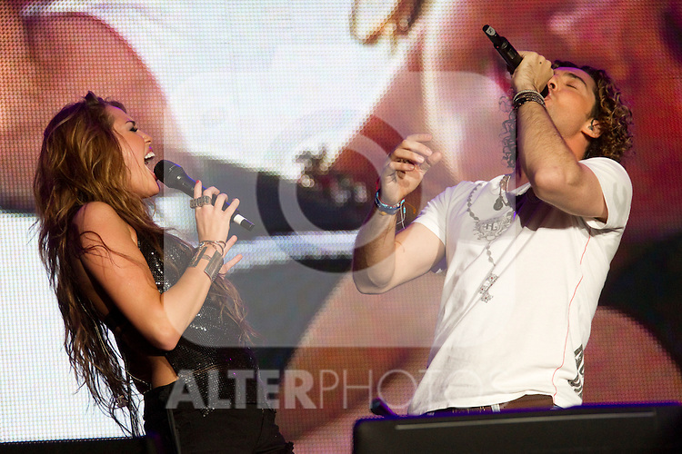 MADRID (06/06/2010).- Miley Cyrus performs during concert at Rock in Rio in Madrid. Pictured Miley Cyrus and David Bisbal...Photo: Cesar Cebolla / ALFAQUI