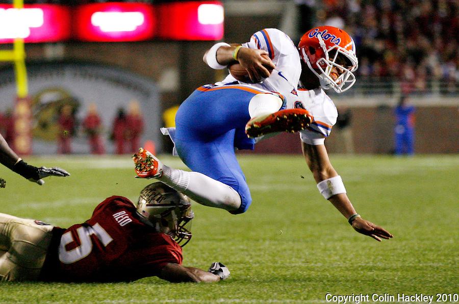 TALLAHASSEE, FL 11/27/10-FSU-UF FB10 CH-Florida State's Greg Reid up ends Florida's Trey Burton during second half action Saturday at Doak Campbell Stadium in Tallahassee. The Seminoles beat the Gators 31-7..COLIN HACKLEY PHOTO