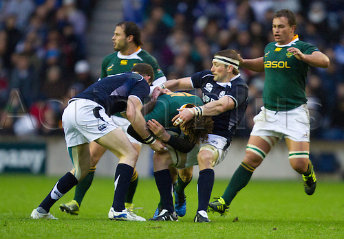 20.11.2010 International Rugby Union from Murrayfield Scotland v South Africa..South Africas 15 Zane Kirchner  gets wrapped up in the tackle