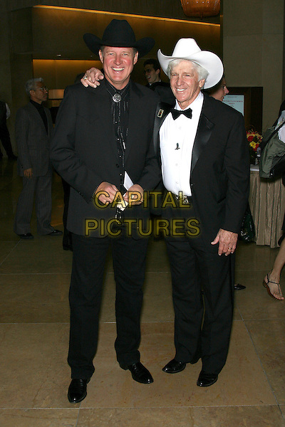 BRUCE BOXLIETNER & DEAN SMITH.The John Wayne Cancer Institute Auxiliary 21st Annual Odyssey Ball held at the Beverly Hilton Hotel, Beverly Hills, California, USA, 8th April 2006..full length cowboy hats.Ref: ADM/ZL.www.capitalpictures.com.sales@capitalpictures.com.©Zach Lipp/AdMedia/Capital Pictures.