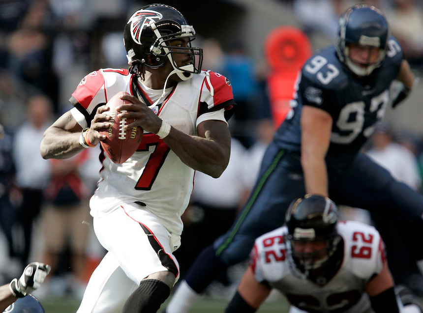 Falcons QB Michael Vick runs out of the pocket during NFL game action home opener Seattle Seahawks versus Atlanta Falcons at Qwest Field in Seattle, Washington on Sunday Sept. 18, 2005(Kevin P. Casey/Wireimage.com)