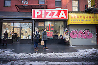 A dollar pizzeria in the Lower East Side neighborhood of New York on Sunday, February 22, 2015.  (© Richard B. Levine)
