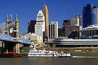 Cincinnati, skyline, OH, Ohio, Downtown skyline of Cincinnati. Barge chugs along the Ohio River.