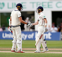 Ivan Thomas (L) congratulates Sam Billings on his fifty for Kent during the County Championship Division Two (day 3) game between Kent and Northants at the St Lawrence ground, Canterbury, on Sept 4, 2018.