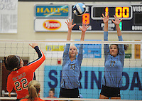 NWA Democrat-Gazette/ANDY SHUPE<br /> Lora Brown (22) of Rogers Heritage sends the ball over the net as Elizabeth Williams (13) and Jaden Williams (17) of Springdale Har-Ber reach to block Thursday, Sept. 17, 2015, at Wildcat Arena in Springdale. Visit nwadg.com/photos to see more photographs from the game.