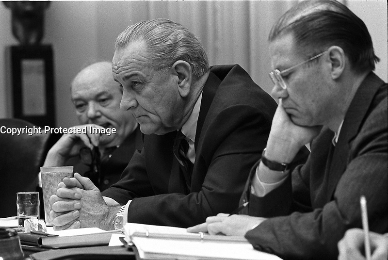 Washington (DC) USA - February 9, 1968 File Photo - <br /> <br /> Secretary of State Dean Rusk, President Lyndon B. Johnson, and Secretary of Defense Robert McNamara at a meeting in the Cabinet Room of the White House.<br /> Robert Strange McNamara (born June 9, 1916) is an American business executive and a former United States Secretary of Defense. McNamara served as U.S. Secretary of Defense from 1961 to 1968, during the Vietnam War. After holding that position he became President of the World Bank (1968-1981). McNamara was responsible for the institution of systems analysis in public policy, which developed into the discipline known today as policy analysis.[1]
