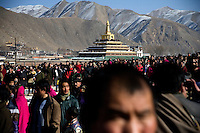 Crowds gather to watch the once-a-year unveiling of a Tibetan Buddhist thangka (painting of Buddha) outside the Labrang Monastery in Xiahe, Gansu, China.