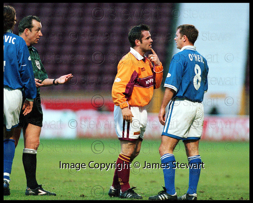 19th December 98       ref : 980423 .Copyright Pic : James Stewart   .MOTHERWELL V ST JOHNSTONE.JOHN SPENCER FACES UP TO JOHN O'NEILL AFTER THEY CLASHED ON THE GROUND AS REFEREE WILLIE YOUNG LOOKS ON.....Payments to :-.James Stewart Photo Agency, Stewart House, Stewart Road, Falkirk. FK2 7AS      Vat Reg No. 607 6932 25.Office : 01324 630007        Mobile : 0421 416997.E-mail : JSpics@aol.com.If you require further information then contact Jim Stewart on any of the numbers above.........