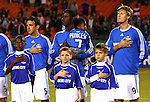 27 October 2007: Kansas City's Kerry Zavagnin (5), Eddie Johnson (with daughter), and Sasha Victorine (9) during the national anthem. The Kansas City Wizards defeated Club Deportivo Chivas USA 1-0 in the first leg of their Major League Soccer Western Conference Semifinal playoff series at Arrowhead Stadium in Kansas City, Missouri.