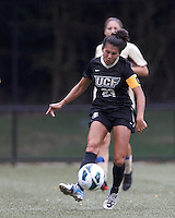University of Central Florida forward Nicolette Radovcic (23) passes the ball. After two overtime periods, Boston College tied University of Central Florida, 2-2, at Newton Campus Field, September 9, 2012.