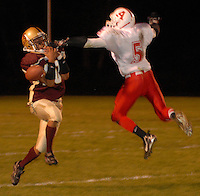 Albion running back junior Durant Crum interferes with a pass intended for Western senior Zach Young during the second quarter at Western on September 29, 2006..photo by Danny Gawlowski