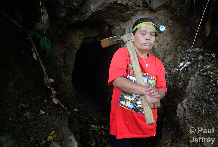 Vicklyn Ebanes, 44, poses outside a small scale gold mine she operates with her husband in the Diwalwal area on the Philippines' southern island of Mindanao. Hers is one of several mining families fighting back against plans to displace them by the Philippine Mining Development Corporation, a front company for foreign mining companies that seeks to install a large-scale open pit gold mine in the area, also known as Mt. Diwata. The small miners were given notice to evacuate the area by June 5 or risk being forcibly removed by the military. The miners have defiantly refused to leave, and formed a formal association to demand respect for their rights in the Philippines courts. Ebanes, who is the chairperson of the local Catholic parish council, was chosen as the association's secretary..