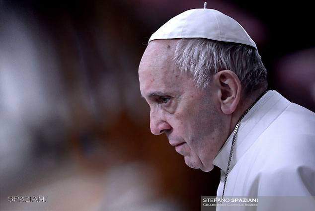 Pope Francis' receives confession during the penitential celebration in St. Peter's Basilica at the Vatican, March 9, 2018