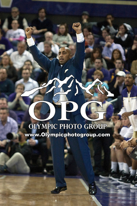 Feb 2, 2012:  Washington head coach Lorenzo Romar signals to his team from the team bench against UCLA.  Washington defeated UCLA 71-69 at Alaska Airlines Arena Seattle, Washington...