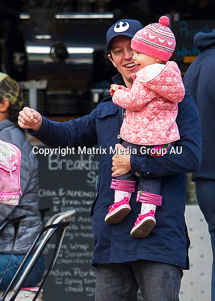 19 JULY 2015, SYDNEY AUSTRALIA<br /> <br /> EXCLUSIVE PICTURES<br /> <br /> Rove McManus pictured with his wife Tasma Walton and daughter Ruby leaving a cafe in Avalon after breakfast with friends and family. Later Rove and Tasma are spotted doing some 'spring' cleaning. <br /> <br /> *No internet without clearance*.<br /> <br />  MUST CALL PRIOR TO USE +61 2 9211-1088. <br /> <br /> Note: All editorial images subject to the following: For editorial use only. Additional clearance required for commercial, wireless, internet or promotional use.Images may not be altered or modified. Matrix Media Group makes no representations or warranties regarding names, trademarks or logos appearing in the images.