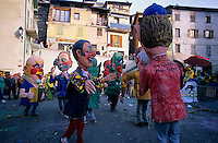 People wearing giant papier-mâché masks and dancing during Shrove Tuesday celebrations in Belvédère, French Alps, France.