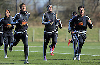 Pictured L-R: Kyle Naughton, Gylfi Sigurdsson and Neil Taylor Thursday 25 February<br />Re: Swansea City FC training at Fairwood, near Swansea, Wales, UK, ahead of their game against Tottenham Hotspur.