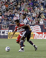 FC Dallas forward David Ferreira(10) and New England Revolution midfielder Joseph Niouky (23) contend for the ball.  The New England Revolution drew FC Dallas 1-1, at Gillette Stadium on May 1, 2010