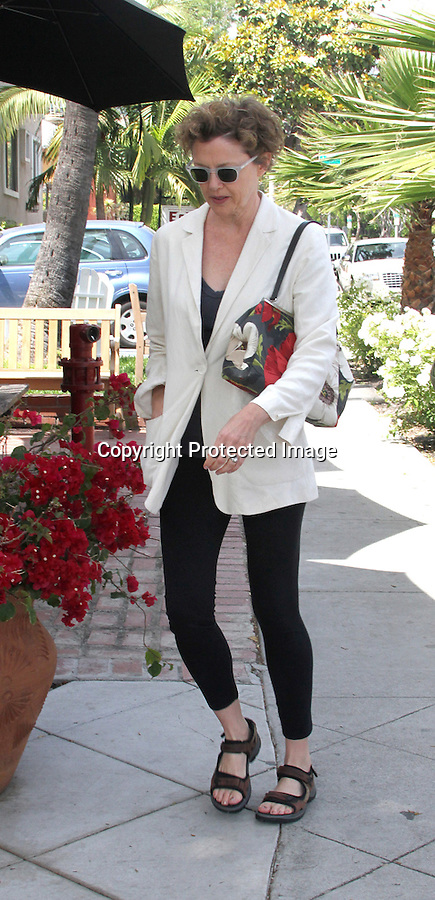 May 13th 2011   Exclusive ..Annette Bening ate lunch with friends at a restaurant called LE Pain Quotidien in West Hollywood. Annette was smiling while carrying a colorful red & white flower purse & blue bracelet rubber wristband bracelet that supports cancer research & tsunami relief. Robert Davi was also inside & talked with Annette for a little while .Sandals white blazer jacket clear sunglasses ...AbilityFilms@yahoo.com.805-427-3519.www.AbilityFilms.com.
