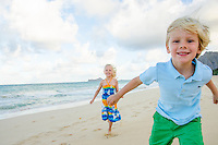 Two children playing on Waimanalo Beach, O'ahu.