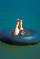 Relaxing on pond in inner tube. Near Alpine, Oregon