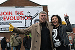 © Joel Goodman - 07973 332324 .  12/01/2015 . Salford , UK . Bez ( Mark Berry ) (left) with his partner Firouzeh Razavi , launches his parliamentary campaign for the constituency of Salford and Eccles at a poster site on Chapel Street , Salford . Bez , the freaky dancer from Madchester band The Happy Mondays , is standing for The Reality Party . Seat incumbent , Labour's Hazel Blears , is standing down at the 2015 election . Photo credit : Joel Goodman