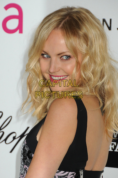 Malin Akerman .20th Annual Elton John Academy Awards Viewing Party held at West Hollywood Park, West Hollywood, California, USA..February 26th, 2012.oscars headshot portrait black green blue print purple pink lipstick side looking over shoulder .CAP/ADM/BP.©Byron Purvis/AdMedia/Capital Pictures.