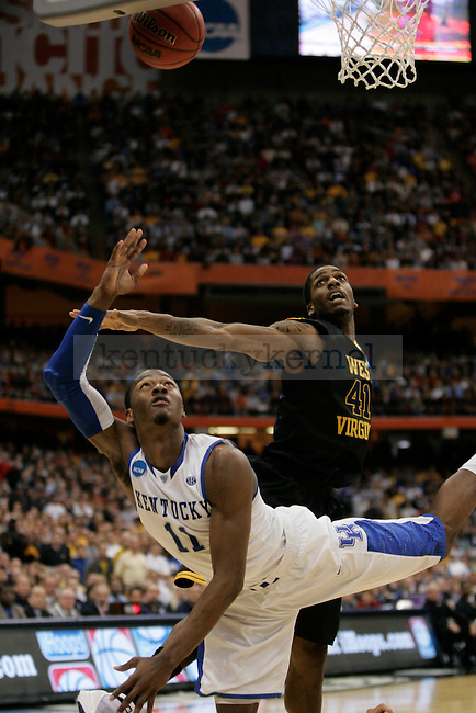 UK's John Wall puts the ball up against West Virginia at the Carrier Dome on Saturday, March 27, 2010. Photo by Scott Hannigan | Staff