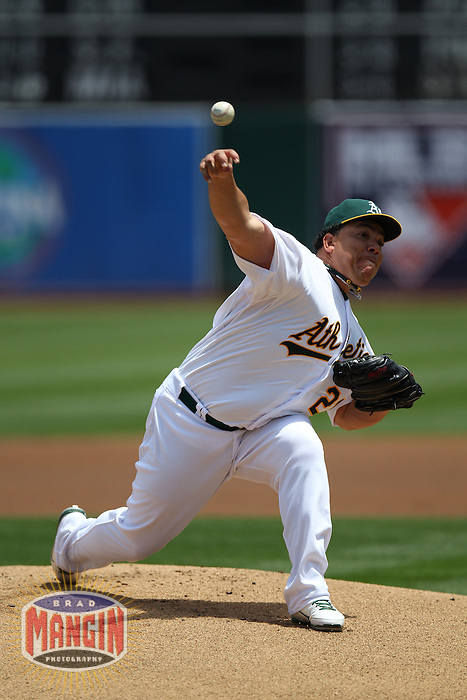 OAKLAND, CA - MAY 26:  Bartolo Colon #21 of the Oakland Athletics pitches against the New York Yankees during the game at O.co Coliseum on Saturday May 26, 2012 in Oakland, California. Photo by Brad Mangin