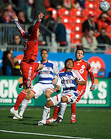 11 April 2009: Toronto FC defender Kevin Harmse # 5 prepares to fly as FC Dallas midfielder David Ferreira #10 watches during an MLS game at BMO Field in Toronto between FC Dallas and Toronto FC. The game ended in a 1-1 draw.