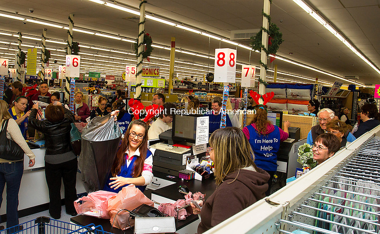 TORRINGTON, CT - 19 NOVEMBER 2016 - 111916JW03.jpg -- Ocean State Job Lot cashier Carah Connell rings up one of the long lines  of customers at the checkout line during the opening of the new store Saturday morning in the space formerly occupied by Kmart.    Jonathan Wilcox Republican-American