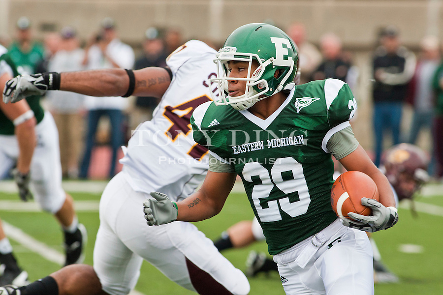 Eastern Michigan wide receiver Chaz Mitchell (29) jukes around Central Michigan linebacker Armond Staten, left, in the first quarter of an NCAA college football game, Saturday, Sept. 18, 2010, in Ypsilanti, Mich. (AP Photo/Tony Ding)