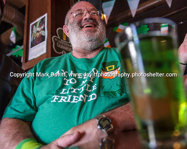 """Founder's Irish Pub held its annual St. Patricks Day Kegs and Eggs featuring green eggs and ham and green beer in Bondurant March 17. Robert """"Buzz"""" Ryan an Irish Catholic from Newton shows off his tee shirt that says """"Say hello to my little friend"""" featuring a Leprechaun. Buzz was lamented his birthday is March 18th not the 17th. He just missed it by that much."""